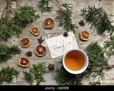 Tea with fir tree branches and dried oranges - Stock Photo
