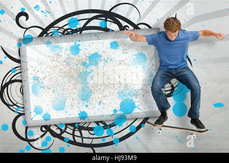 Skateboarder mid ollie in front of copy space screen with blue paint splashes and black decorative frame - Stock Photo