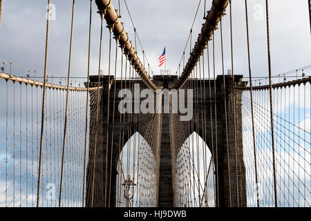 Looking up at a Tower of the Brooklyn Bridge, NYC. Suspension Cables Abound. - Stock Photo