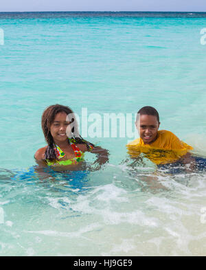 Children at Shoal Bay in Anguilla - Stock Photo