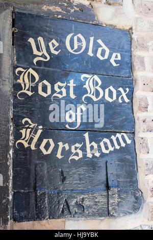 Historic 'Ye Olde Post Box of Horsham' on wall, Market Square, Horsham, West Sussex, England, United Kingdom - Stock Photo