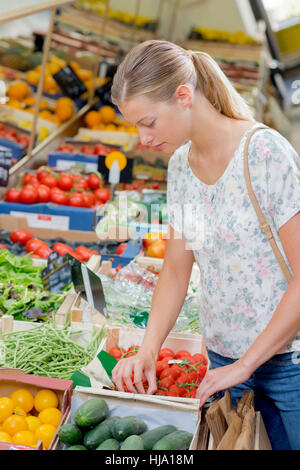 Young woman at the greengrocer's - Stock Photo