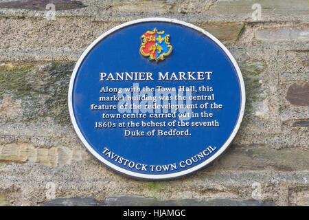Blue plaque on wall at Tavistock Pannier Market, Tavistock, Devon, England, United Kingdom - Stock Photo