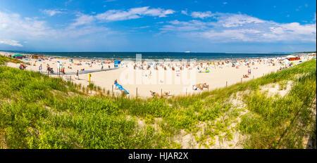 Panoramic view of crowded Baltic sea beach on Usedom island in Swinoujscie, Poland - Stock Photo