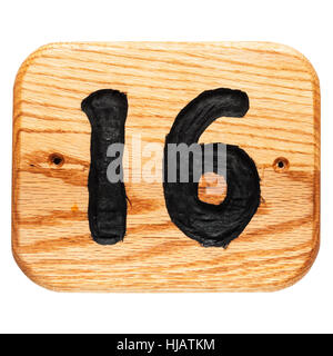 A handmade oak house number sign on a white background - Stock Photo