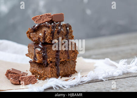 Chocolate pumpkin brownies with slices of chocolate and syrup. Love for a healthy desserts concept. - Stock Photo
