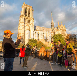 Indian tourists visiting Paris, Notre Dame cathedral, France - Stock Photo