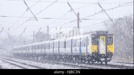Class 317 Electic Multiple Unit , 317337 Seen In A Snow Storm, Brookmans Park, Hertfordshire, England, UK - Stock Photo
