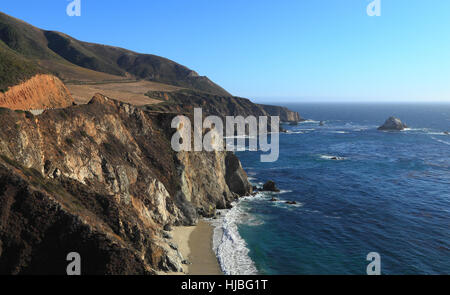Southward view of State Route 1 on the Big Sur coast of California, just south of the historic Bixby Bridge. - Stock Photo