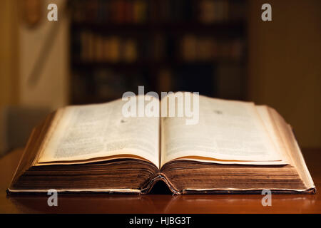 150 year old open Bible in library - Stock Photo