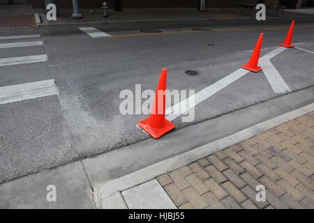 Orange roadwork cones on the asphalt road. - Stock Photo