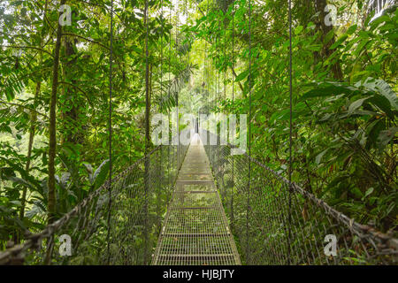 Hanging bridge at natural rainforest park in Costa Rica - Stock Photo