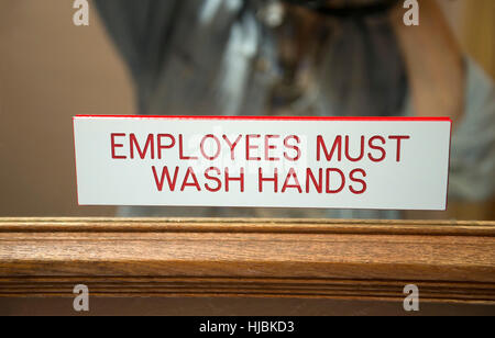 Employees must wash hands sign in restaurant bathroom    Stock Photo. Wash Your Hands Sign In A Bathroom Showing Different Languages