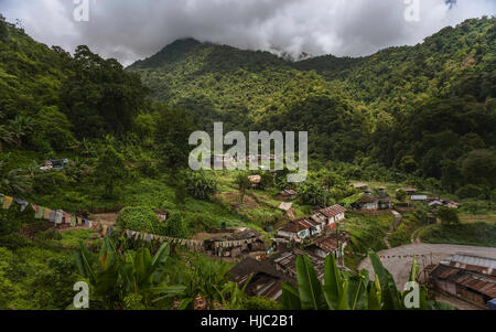 A small village surround by Himalaya foothills and forested slopes on side of Indian highway 229 near Bomdila, Arunachal - Stock Photo