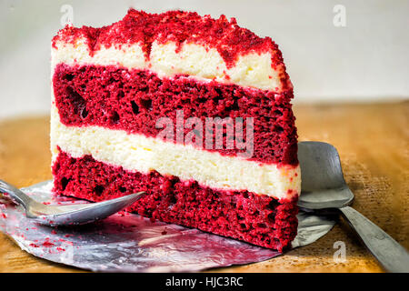 piece of red velvet cake on wood dish and silver spoon - can use to display or montage on product - Stock Photo