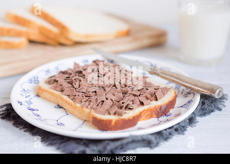 A sandwich with chocolate sprinkles or 'vlokken', Dutch traditional food. - Stock Photo