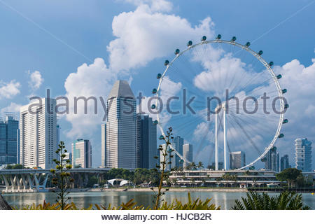 Skyline of Singapore and Singapore Flyer - Stock Photo