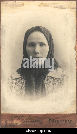 Vintage photo. Portrait of the an elderly woman in a headscarf. Photorgapher Kadisson, Petrograd, Russia, circa - Stock Photo