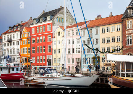 Ships and colourful buildings in the Nyhavn area of Copenhagen. - Stock Photo