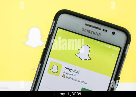 Man holding Samsung smartphone in hand, with Snapchat app running is seen in Gdansk, Poland  on 24 January 2017 - Stock Photo