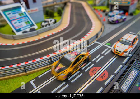 London, UK. 24th Jan, 2017. Tablet app controller and Scalextrics set on the Hornby stand - The London Toy Fair - Stock Photo