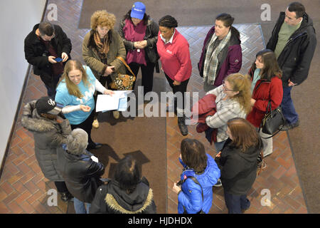 Melville, New York, USA. 24th Jan, 2017. Fourteen members of Together We Will Long Island gather in lobby of bulding - Stock Photo
