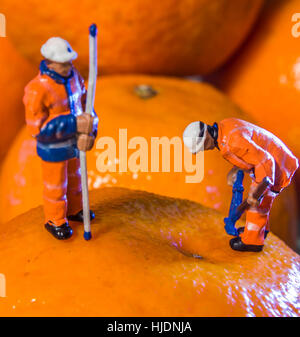 Miniature figures and everyday items to make, bizarre, amusing or though provoking images. Fun for the young and - Stock Photo