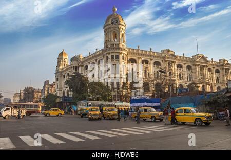 Famous Indian city road landmark Chowringhee Dharamtala crossing Kolkata with colonial heritage buildings. - Stock Photo