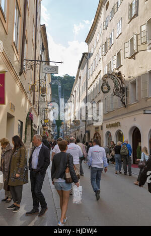 SALZBURG, AUSTRIA - SEPTEMBER 09, 2015: A lot of people visit the popular street Getreidegasse, one of the oldest - Stock Photo