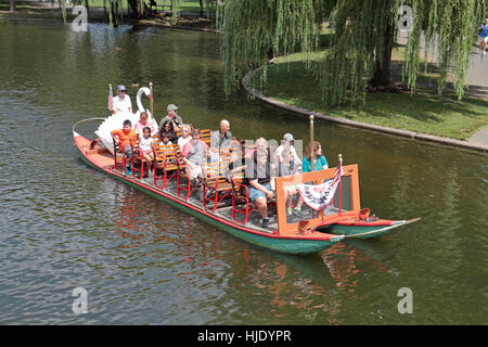 A Boston Swan Boat in the Lagoon, Public Garden, Boston, Massachusetts, United States. - Stock Photo
