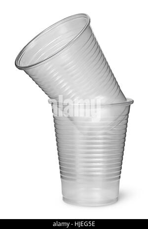 Two plastic cups each other isolated on white background - Stock Photo