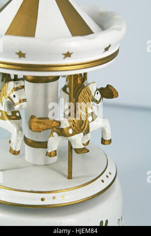 Small carousel figures. Carousel toy. - Stock Photo