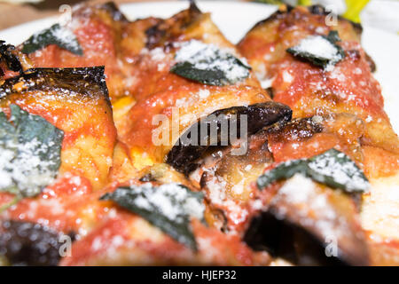 rolled slices of eggplant, stuffed with ham and cheese, served with tomato basil and grated Parmesan cheese and - Stock Photo
