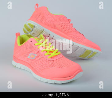 Pair of pink Skechers running shoes cut out isolated on white background - Stock Photo