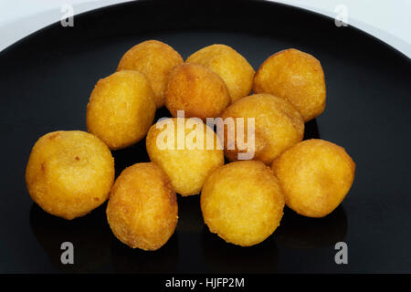 Thai snack, fried potato balls on black plate.jpg - Stock Photo
