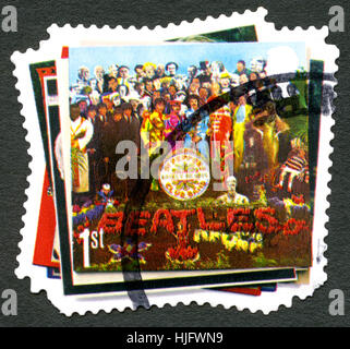 UK - CIRCA 2007: A used postage stamp from the UK, with the album cover of Sgt Peppers Lonely Hearts Club Band by - Stock Photo