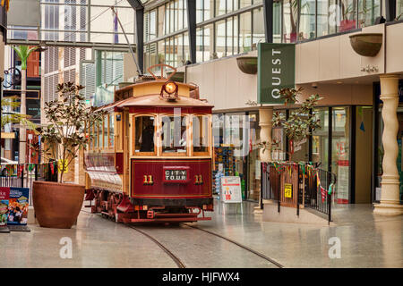 Vintage tramcars in Cathedral Junction, a combined shopping mall and tram stop in the centre of Christchurch, New - Stock Photo