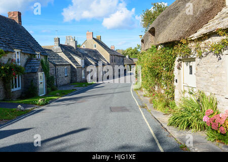 Traditional hamlet, street with houses with thatched roofs - Stock Photo