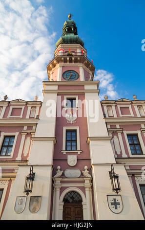 Town hall tower with the big old clock. Zamosc. Poland - Stock Photo