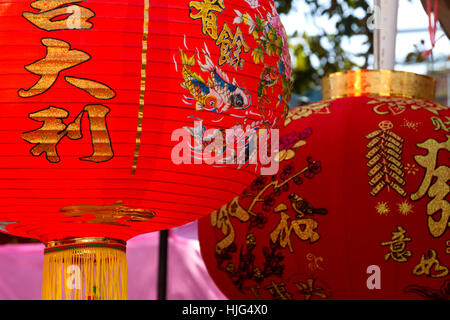 chinese traditional red paper lanterns with hieroglyphs for lunar new year close up selective focus - Stock Photo
