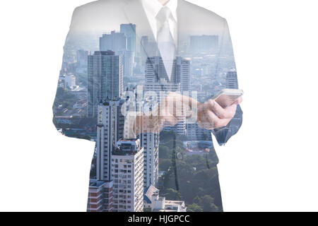 Double exposure of business man hand hold and touch screen smart phone, mobile and city - Stock Photo