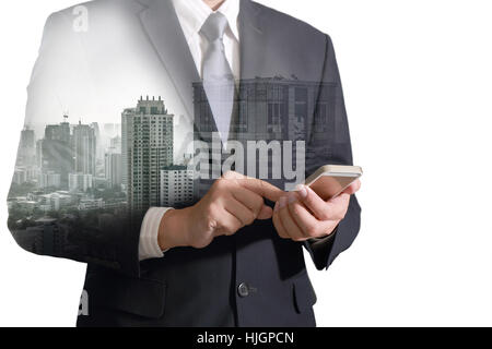 Double exposure of city and business man hand touch screen smart phone as business concept. - Stock Photo