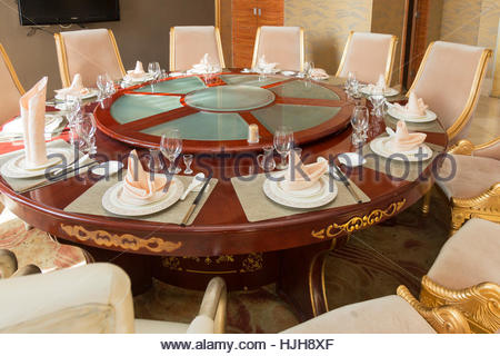 Place settings at Chinese restaurant dinner table, Wuzhong, Ningxia province, China - Stock Photo
