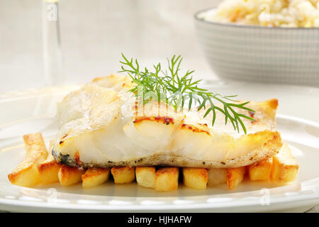 Baked fish and chips on white plate - Stock Photo