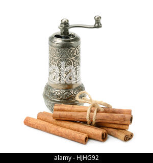 cinnamon and manual coffee grinder isolated on white background - Stock Photo