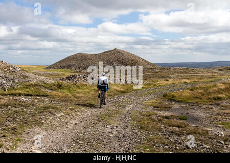 Mountain Biker Passing Through the Mining Grounds on the Northern Slopes of  Great Pinseat Above Arkengarthdale, - Stock Photo