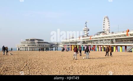 People on the beach near Scheveningen Pier at  the North Sea beach resort of Scheveningen - Den Haag (The Hague), - Stock Photo