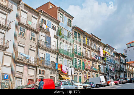 PORTO, PORTUGAL - APRIL 30, 2012: The old residential neighborhood with tall narrow houses, attached close to each - Stock Photo