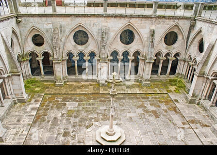 PORTO, PORTUGAL - APRIL 30, 2012: The stone cross in the middle of Gothic Cloister of Cathedral, on April 30 in - Stock Photo