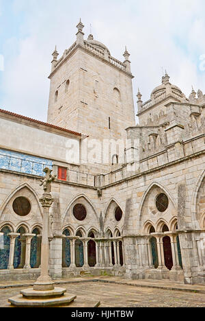 PORTO, PORTUGAL - APRIL 30, 2012: Se Cathedral with its medieval cloister is the fine example of the Gothic Style, - Stock Photo